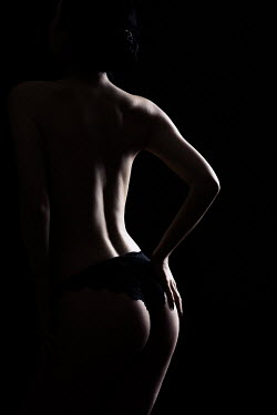 Magdalena Russocka woman wearing black lace panties standing in shadow