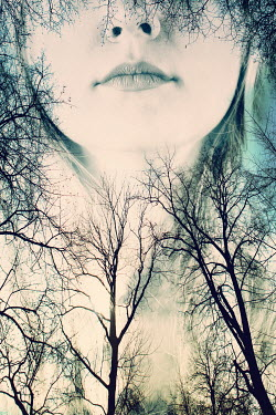 Magdalena Russocka double exposure of woman and bare trees