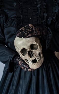 Jaroslaw Blaminsky HISTORICAL WOMAN IN BLACK HOLDING SKULL