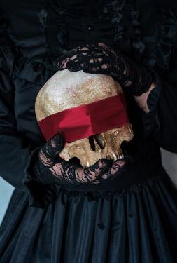 Jaroslaw Blaminsky HISTORICAL WOMAN HOLDING SKULL with red blindfold