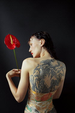 Marta Bevacqua WOMAN IN BODICE WITH LARGE TATTOO AND FLOWER