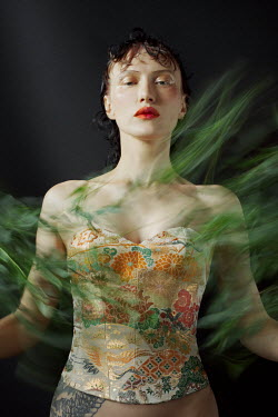 Marta Bevacqua WOMAN IN BODICE WITH MOVING LEAVES