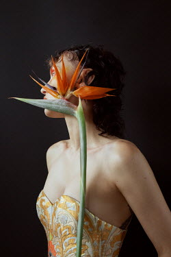 Marta Bevacqua WOMAN IN BODICE WITH EXOTIC FLOWER