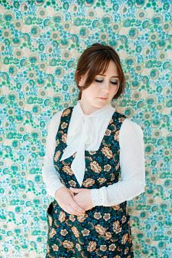 Shelley Richmond SERIOUS BRUNETTE RETRO WOMAN IN FLORAL DRESS