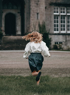 Eve North LITTLE GIRL RUNNING TOWARDS GRAND BUILDING