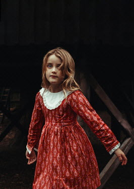 Eve North SERIOUS LITTLE GIRL IN RED DRESS BY DOORWAY