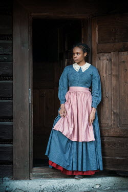 Magdalena Russocka historical african woman standing on threshold of old cabin