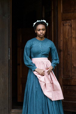 Magdalena Russocka historical african maid standing on threshold of old cabin