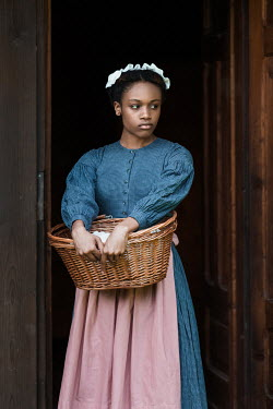 Magdalena Russocka historical african maid standing by old cabin