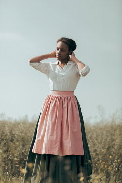 Magdalena Russocka historical african woman standing in field