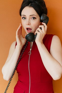 Shelley Richmond SURPRISED 1960S WOMAN HOLDING TELEPHONE