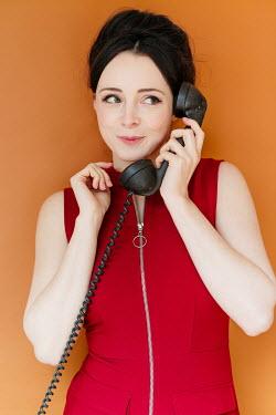 Shelley Richmond HAPPY 1960S WOMAN HOLDING TELEPHONE