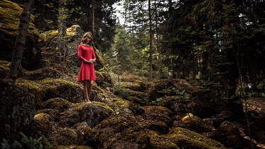 Georgy Chernyadyev WOMAN IN RED DRESS STANDING IN FOREST