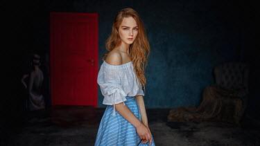 Georgy Chernyadyev GIRL WITH LONG RED HAIR IN DARK ROOM