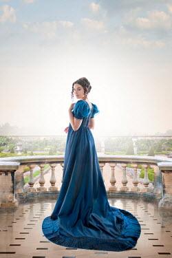 Lee Avison regency woman on the terrace overlooking a formal garden