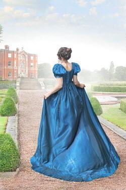 Lee Avison regency woman walking towards a mansion house
