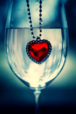 Magdalena Russocka red heart shaped pendant submerged in glass of water