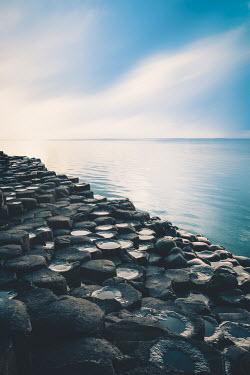 Evelina Kremsdorf ROCKS BY CALM SEA WITH BLUE SKY