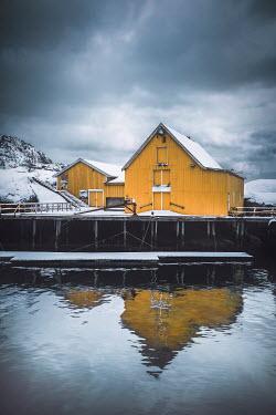 Evelina Kremsdorf SNOWY NORWEGIAN BUILDING REFLECTED IN WATER