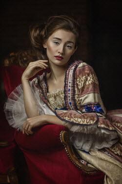 Beata Banach SERIOUS HISTORICAL WOMAN SITTING INDOORS