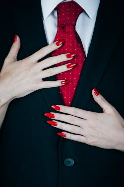 Magdalena Russocka woman's hands on torso of man in suit