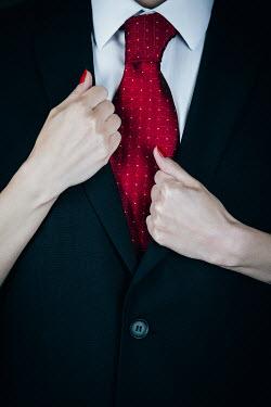 Magdalena Russocka woman's hand holding man's jacket lapels