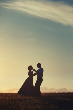 Magdalena Russocka historical couple dancing in field at sunset