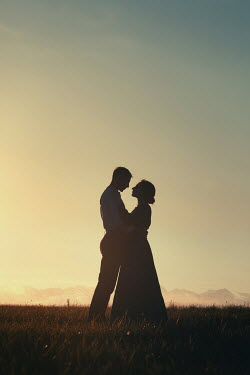 Magdalena Russocka historical couple embracing in field at sunset