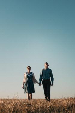 Magdalena Russocka retro couple walking in field