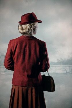 Magdalena Russocka retro woman watching bridge over river
