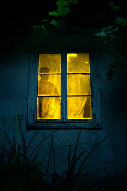 Magdalena Russocka silhouette of man in window of old building at night