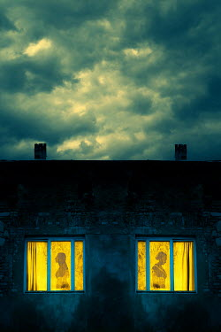 Magdalena Russocka silhouettes of two women in old building windows at night