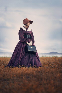 Magdalena Russocka historical woman carrying suitcase woman standing in field