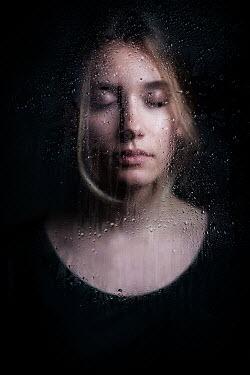 Ildiko Neer Closed eyes woman behind wet glass