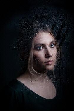 Ildiko Neer Young woman behind wet glass