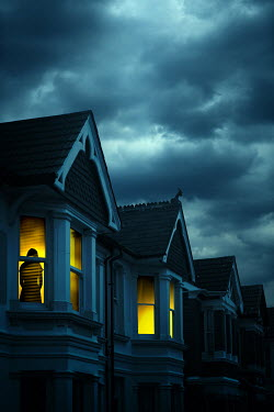 Magdalena Russocka silhouette of woman in window of historical  townhouse at night