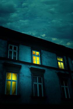 Magdalena Russocka old storey building with illuminated windows at night