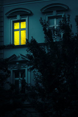 Magdalena Russocka old storey building with illuminated window at night