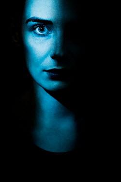 Magdalena Russocka close up of woman staring in shadow