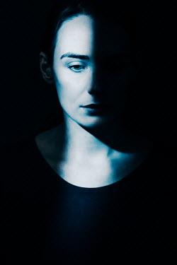 Magdalena Russocka close up of sad woman in shadow
