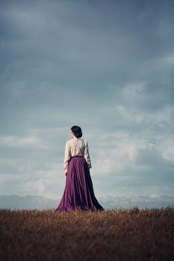 Magdalena Russocka historical woman standing in field