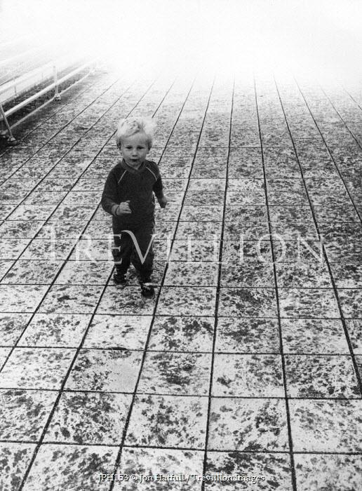Jon Hatfull YOUNG BOY ON TILED FLOOR Children