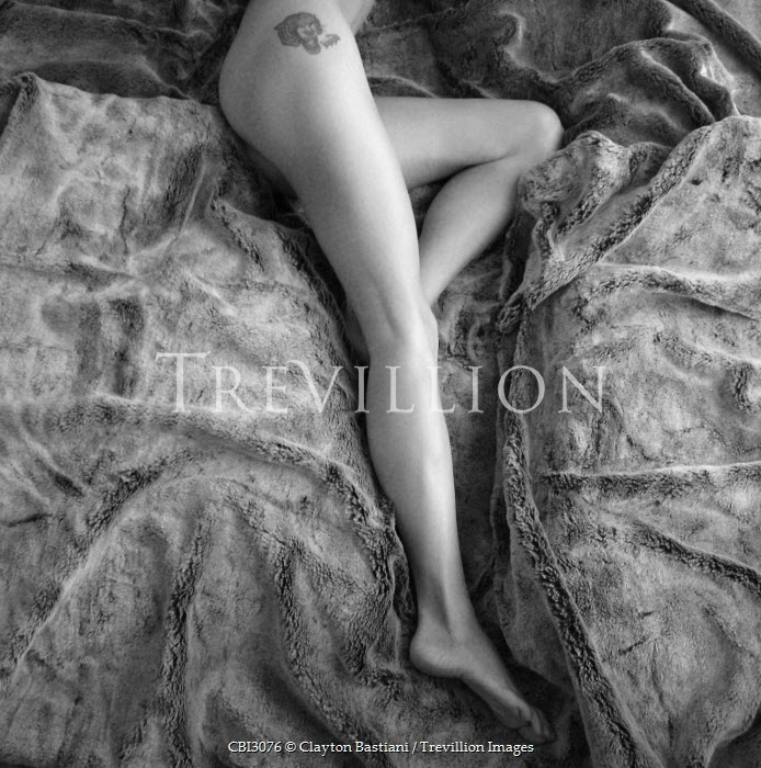Clayton Bastiani WOMAN'S LEGS ON BED Women