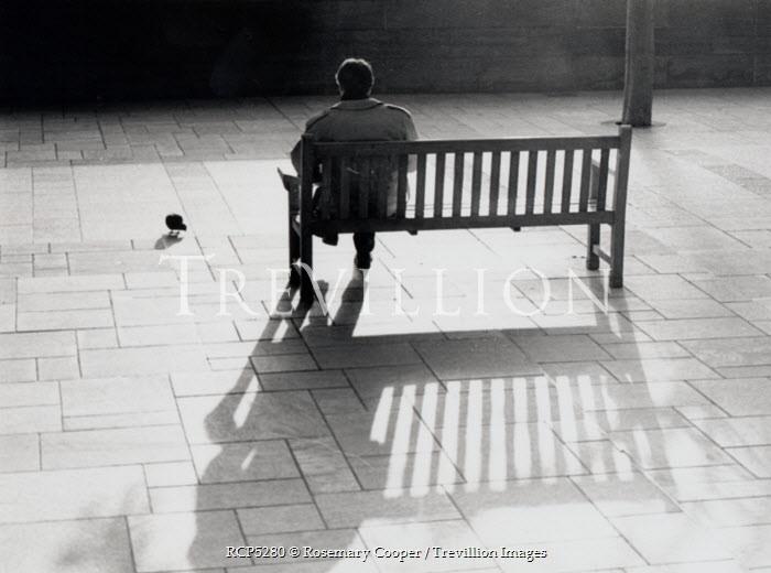 Rosemary Cooper MAN SITTING ON BENCH Men