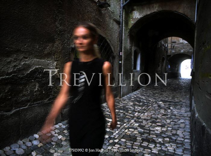 Jon Hatfull WOMAN WALKING DOWN ALLEYWAY Women