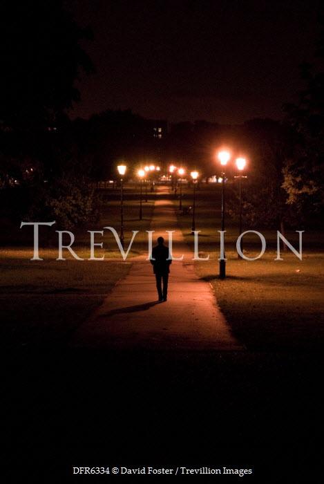 David Foster MAN WALKING THROUGH PARK AT NIGHT Women