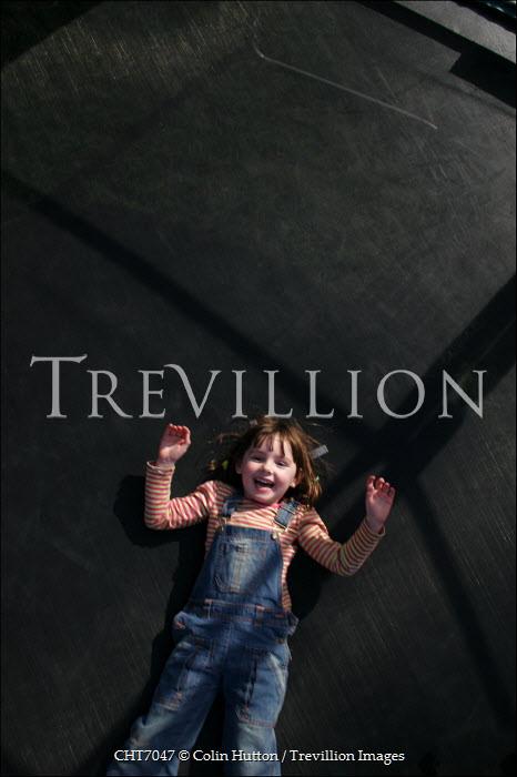 Colin Hutton GIRL LYING DOWN OUTSIDE SMILING Children