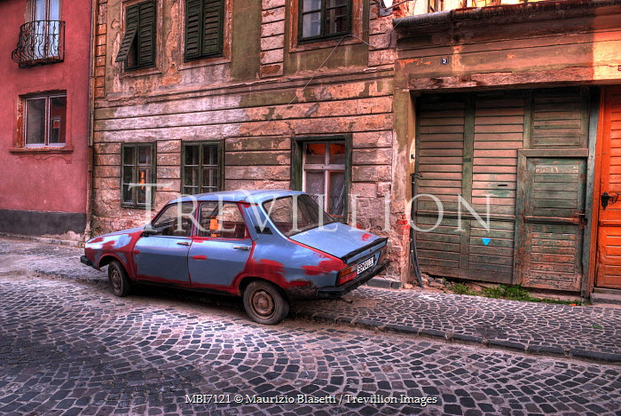 Maurizio Blasetti RUSTY CAR ON TOWN STREET Streets/Alleys