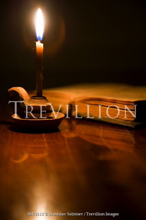 Stanislav Solntsev LIT CANDLE BY BOOK Miscellaneous Objects