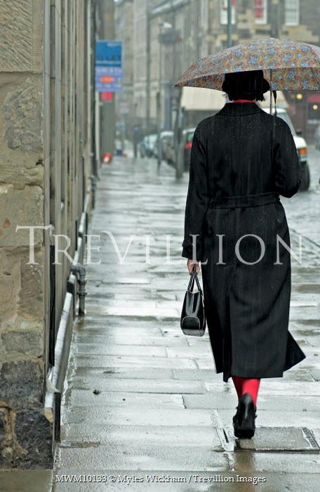 Myles Wickham WOMAN WALKING WITH UMBRELLA Women